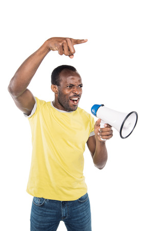 portrait of angry african american man with bullhorn pointing away isolated on white