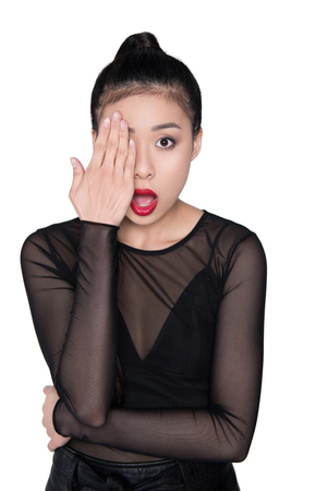 shocked asian woman covering eye with hand isolated on white Stock Photo