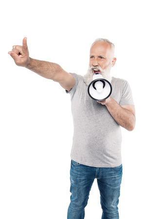 portrait of shouting senior man with loudspeaker and outstretched arm isolated on white