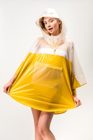 beautiful woman posing in yellow raincoat isolated on white Stockfoto