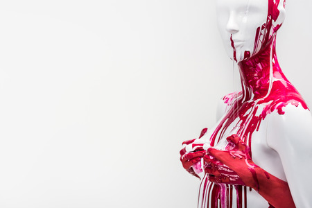 cropped image of woman in red paint touching mannequin breasts isolated on white Stockfoto