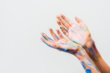 cropped image of girl with colorful bright body art showing hands isolated on white