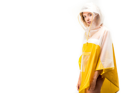 beautiful woman in raincoat looking at camera isolated on white
