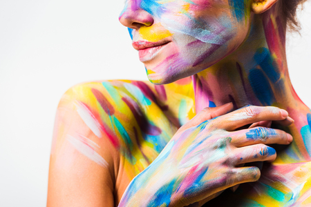 cropped image of girl with colorful bright body art touching neck isolated on white Stock Photo