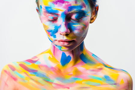 attractive girl with colorful bright body art and closed eyes isolated on white Stock Photo