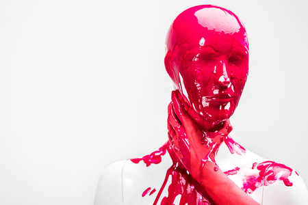 cropped image of woman in red paint touching mannequin neck with hand isolated on white Stock Photo