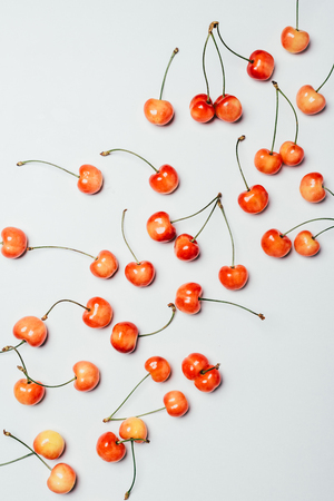 top view of fresh ripe sweet cherries on white background Stock Photo