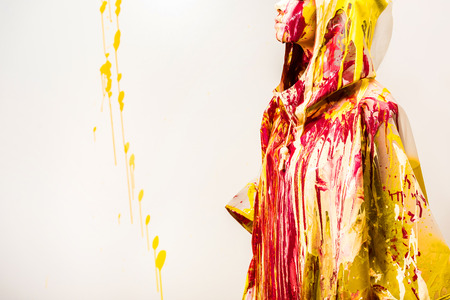 cropped image of woman in raincoat painted with colored paints isolated on white Stock fotó