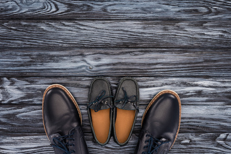 top view of father and kid shoes on wooden tabeltop, Happy fathers day concept