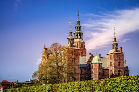 beautiful palace on green hill against blue sky, copenhagen, denmark
