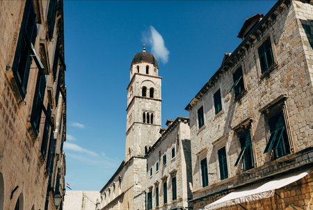 low angle view of historical buildings and clear blue sky in Dubrovnik, Croatia