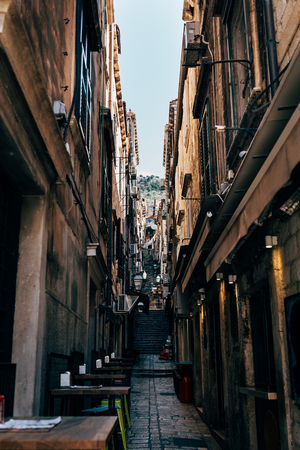 urban scene with empty narrow street in Dubrovnik city, Croatia