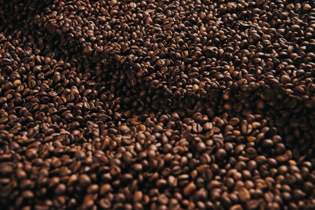 Close-up view of coffee beans roasted in professional machine