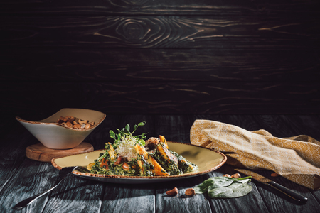 food composition of panikesh with cashew nuts and spinach on wooden table 版權商用圖片