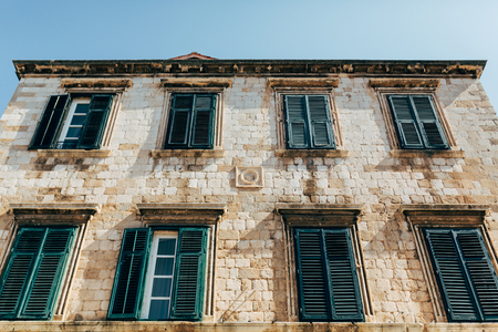low angle view of historical building and clear blue sky in Dubrovnik, Croatia