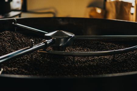 Roasting coffee beans in large coffee roaster