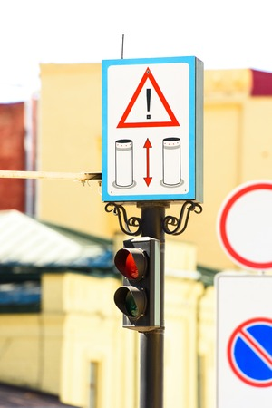 close up view of road signs and semaphore with blurred background Stock Photo