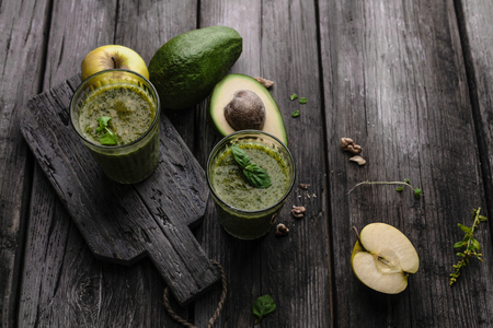 Organic fruit smoothie with avocado on wooden background