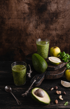Fresh healthy smoothie on rustic table with fruits and herbs Stock Photo
