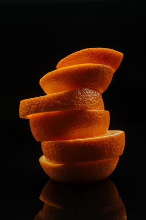 close-up shot of stacked slices of ripe orange isolated on black 版權商用圖片