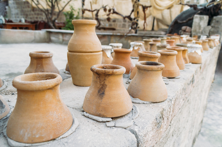 closeup shot of clay jugs placed in row in Cappadocia, Turkey