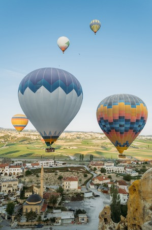 closeup view of colorful hot air balloons over city in Cappadocia, Turkey