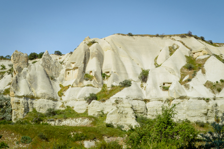 scenic view of slopes in valley under bright blue sky, Cappadocia, Turkey