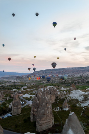 front view of hot air balloons flying over stone formations, Cappadocia, Turkey 版權商用圖片