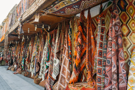 front view of different carpets at market in Cappadocia, Turkey