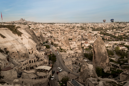 aerial view of cars and buildings from stone formations in Cappadocia, Turkey 版權商用圖片