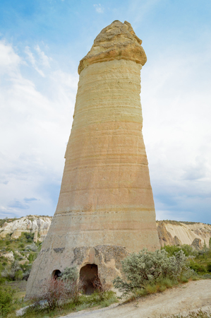 close up view of fairy chimney in valley under cloudy blue sky, Cappadocia, Turkey 版權商用圖片