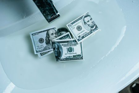 elevated view of dollar banknotes in water in sink