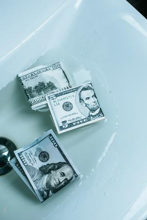 top view of dollar banknotes in water in sink Stock fotó