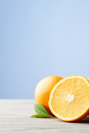 close-up shot of ripe oranges on wooden surface Stock Photo