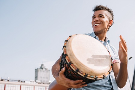 Hipster african american street drummer performing outdoors Stock Photo