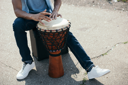 Cropped view of African american man with djembe performing on street Stock fotó