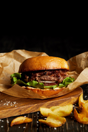 Tempting fast food diner with burger and golden fried poatato Stock Photo