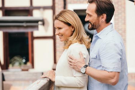 side view of couple hugging on bridge Stock fotó
