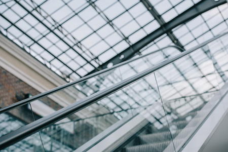 grey moving staircase with stairs and glass roof in shopping mall Stock fotó