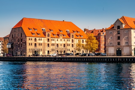 COPENHAGEN, DENMARK - MAY 6, 2018: river, cityscape with buildings and cars Editorial