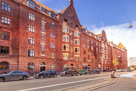 COPENHAGEN, DENMARK - MAY 6, 2018: cityscape with buildings, cars and empty street Editorial