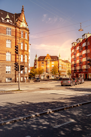 COPENHAGEN, DENMARK - MAY 6, 2018: cityscape with buildings, street and cars