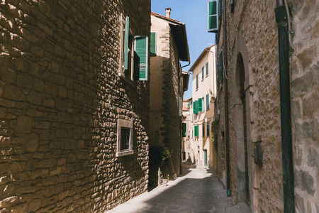urban scene with narrow street and architecture of Tuscany, Italy