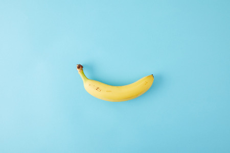 top view of fresh banana isolated on blue