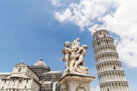 Leaning tower and sculpture of angels on Square of Miracles in Pisa, Italy