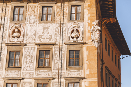 close up of ancient house with sculptures in old european city, Pisa, Italy 写真素材