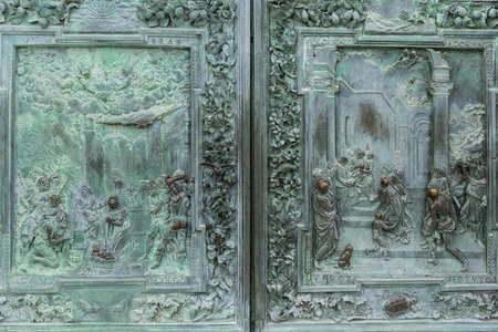 close up of antique metal high relief and ornament on door, Pisa, Italy