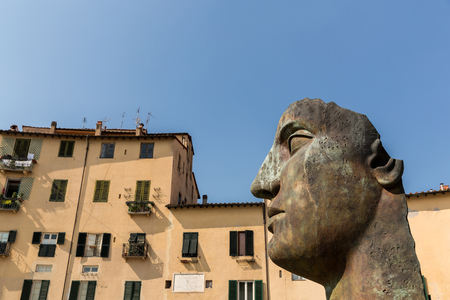 sculpture of head in historical mediterranean city, Pisa, Italy Stock Photo