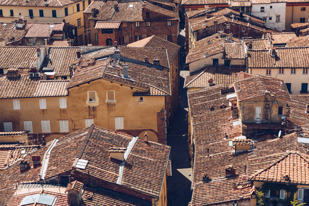 aerial view of ancient roofs of old Pisa city, Italy