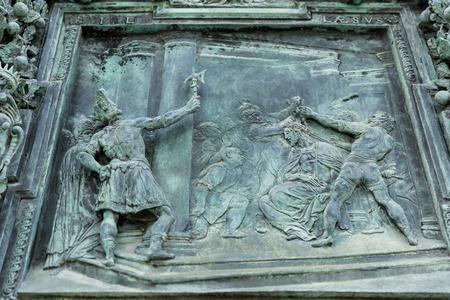 close up of ancient metal high relief on door, Pisa, Italy